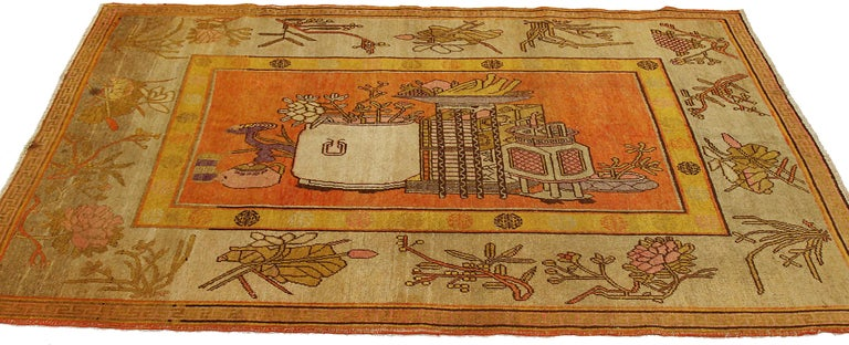 Antique Russian area rug handwoven from the finest sheep's wool. It's colored with all-natural vegetable dyes that are safe for humans and pets. It's a traditional Khotan design handwoven by expert artisans. It's a lovely area rug that can be