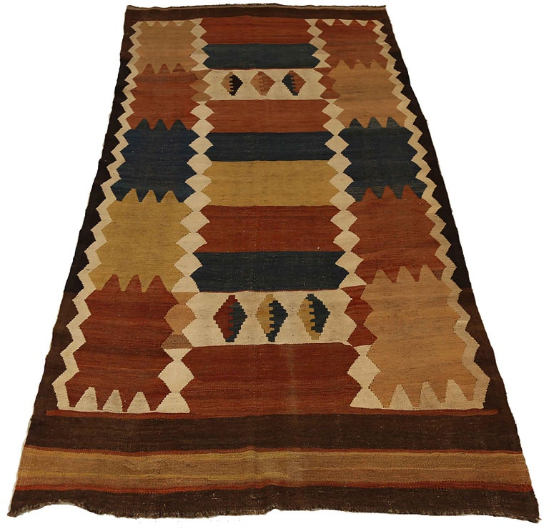 Antique Russian area rug handwoven from the finest sheep's wool. It's colored with all-natural vegetable dyes that are safe for humans and pets. It's a traditional Kilim design handwoven by expert artisans. It's a lovely area rug that can be