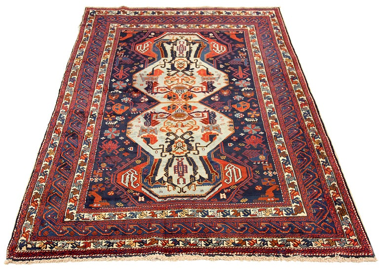 Antique Russian area rug handwoven from the finest sheep's wool. It's colored with all-natural vegetable dyes that are safe for humans and pets. It's a traditional Russian design handwoven by expert artisans. It's a lovely area rug that can be