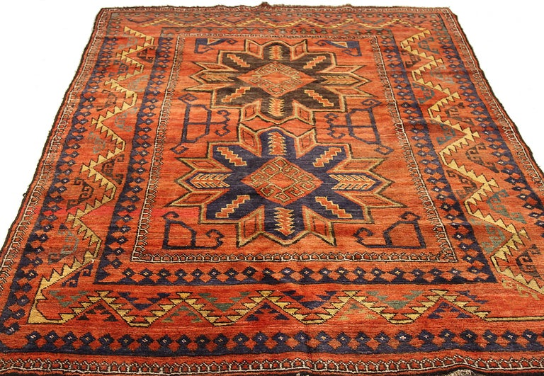 Antique Russian area rug handwoven from the finest sheep's wool. It's colored with all-natural vegetable dyes that are safe for humans and pets. It's a traditional Samarghand design handwoven by expert artisans. It's a lovely area rug that can be