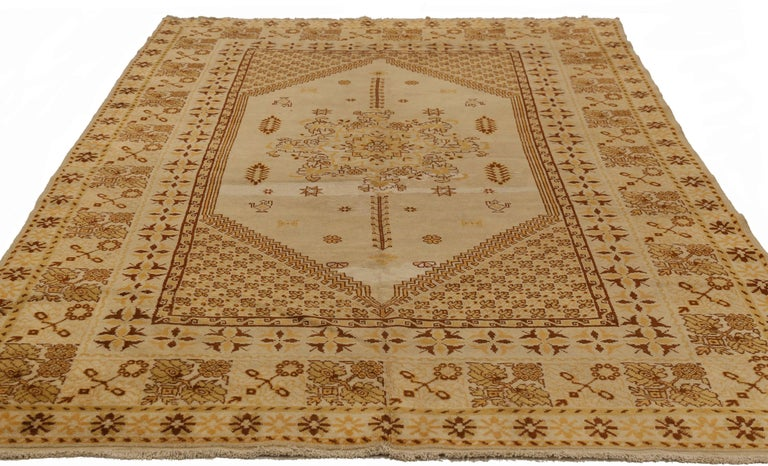 Antique Russian area rug handwoven from the finest sheep's wool. It's colored with all-natural vegetable dyes that are safe for humans and pets. It's a traditional Samarkand design handwoven by expert artisans. It's a lovely area rug that can be