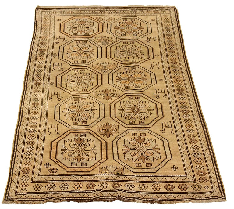 Antique Russian area rug handwoven from the finest sheep's wool. It's colored with all-natural vegetable dyes that are safe for humans and pets. It's a traditional Shirvan design handwoven by expert artisans. It's a lovely area rug that can be