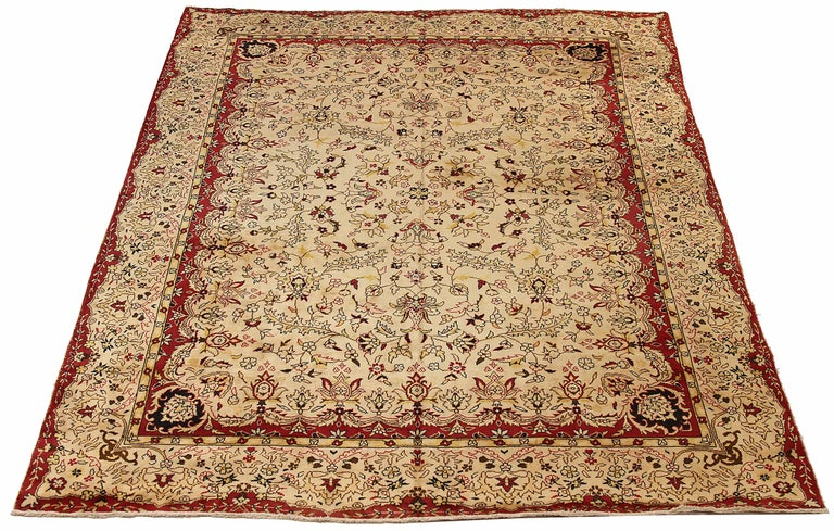 Antique Russian area rug handwoven from the finest sheep's wool. It's colored with all-natural vegetable dyes that are safe for humans and pets. It's a traditional Tabriz design handwoven by expert artisans. It's a lovely area rug that can be