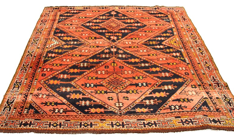 Antique Russian area rug handwoven from the finest sheep's wool. It's colored with all-natural vegetable dyes that are safe for humans and pets. It's a traditional Uzbak design handwoven by expert artisans. It's a lovely area rug that can be