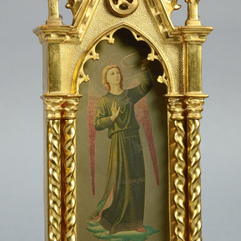 An antique Russian Icon offes ornate giltwood cathedral form and footed frame housing full length portrait of winged saints, circa 1890  Measures: 19