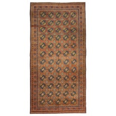 Antique Russian Khotan Rug with Beige & Navy Octagon Medallions on Orange Field