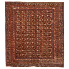 Antique Russian Khotan Rug with Black & Ivory Octagon Medallions on Red Field