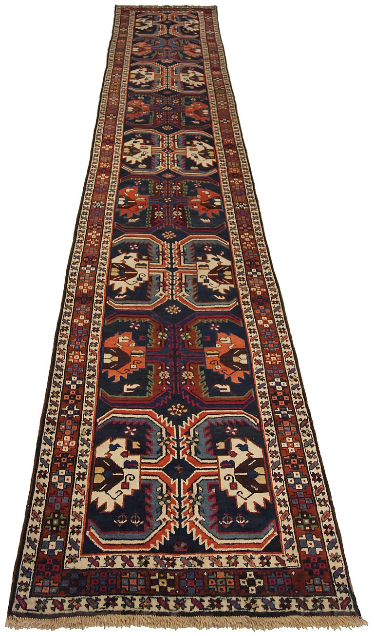 Antique Russian runner rug handwoven from the finest sheep's wool. It's colored with all-natural vegetable dyes that are safe for humans and pets. It's a traditional Karebagh design handwoven by expert artisans. It's a lovely runner rug that can be