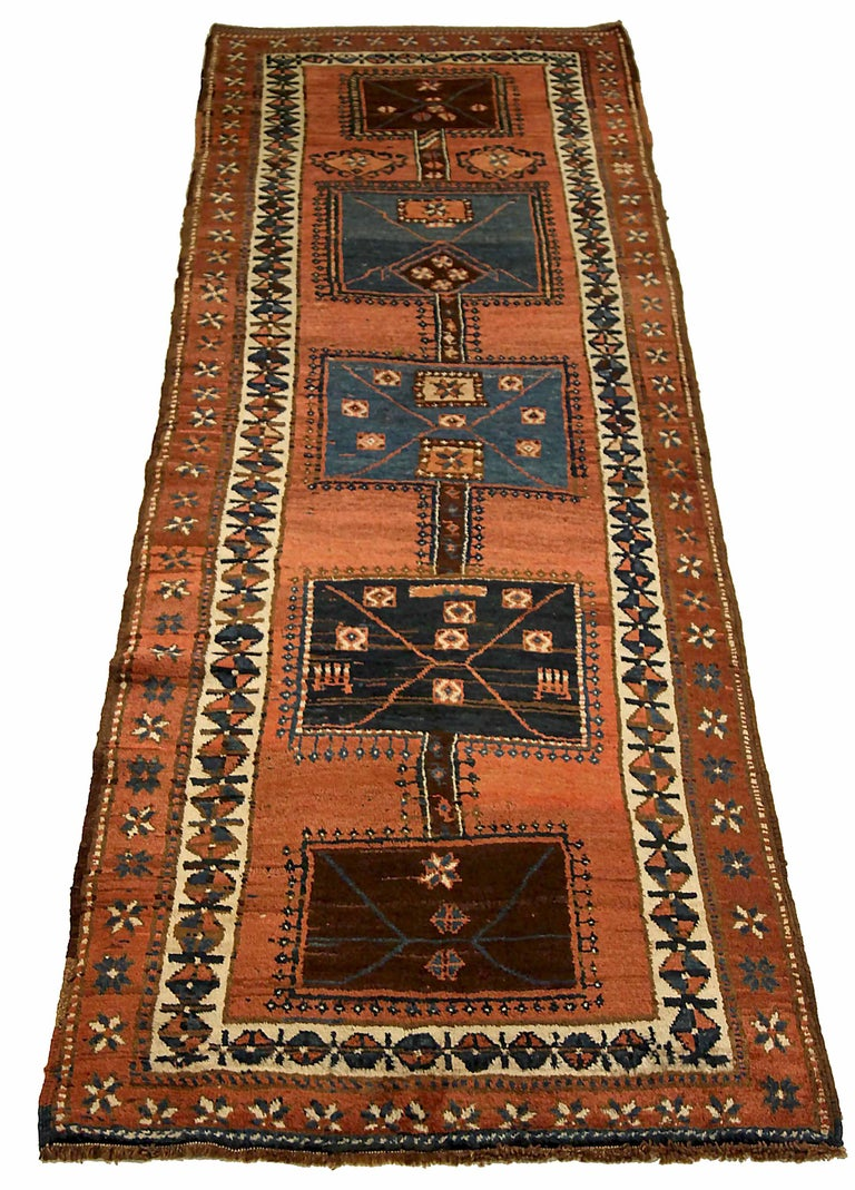 Antique Russian runner rug handwoven from the finest sheep's wool. It's colored with all-natural vegetable dyes that are safe for humans and pets. It's a traditional Kazak design handwoven by expert artisans. It's a lovely runner rug that can be