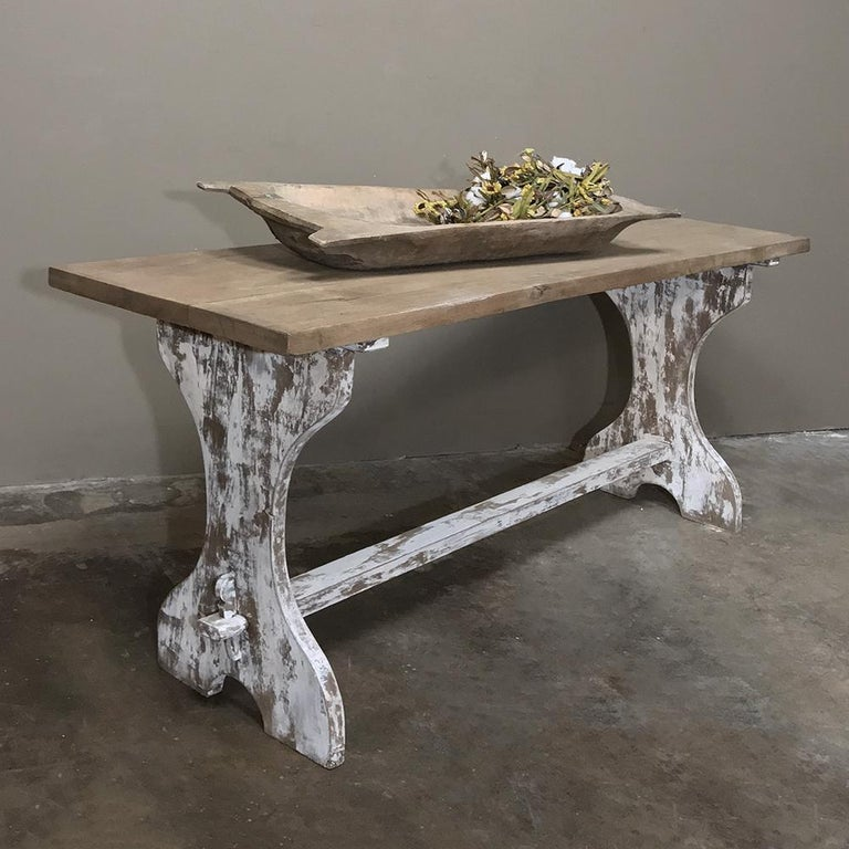 Antique rustic painted Country French trestle table features a narrow width making it a great choice for a rustic sofa table! Handcrafted from solid oak timbers to last for centuries, it features sturdy side supports connected with a lower trestle
