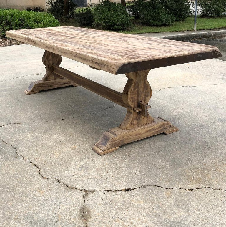 Antique rustic stripped sycamore trestle table is the ideal choice for casual living, with a generous overhang on each end and plenty of legroom underneath thanks to the raised trestle, shimmed in place as has been the custom for talented