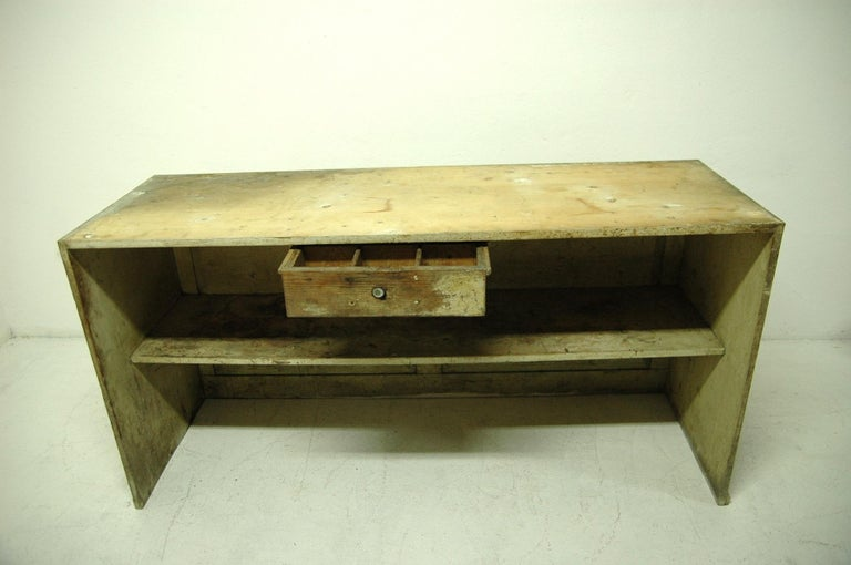 Antique sales counter from the 1920s. This table was made of spruce or pine wood. It was used as a sales counter in a grocery store in Bohemia. Structurally very well preserved, the surface bears a natural patina due to age and use.  Measures: