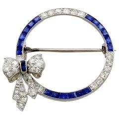 Antique Sapphire and 1.27 Carat Diamond Platinum Bow Brooch, circa 1910