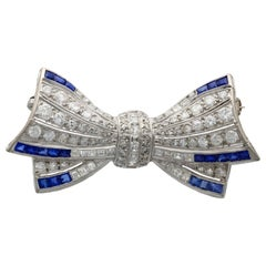 Antique Sapphire and 3.10 Carat Diamond White Gold Bow Brooch