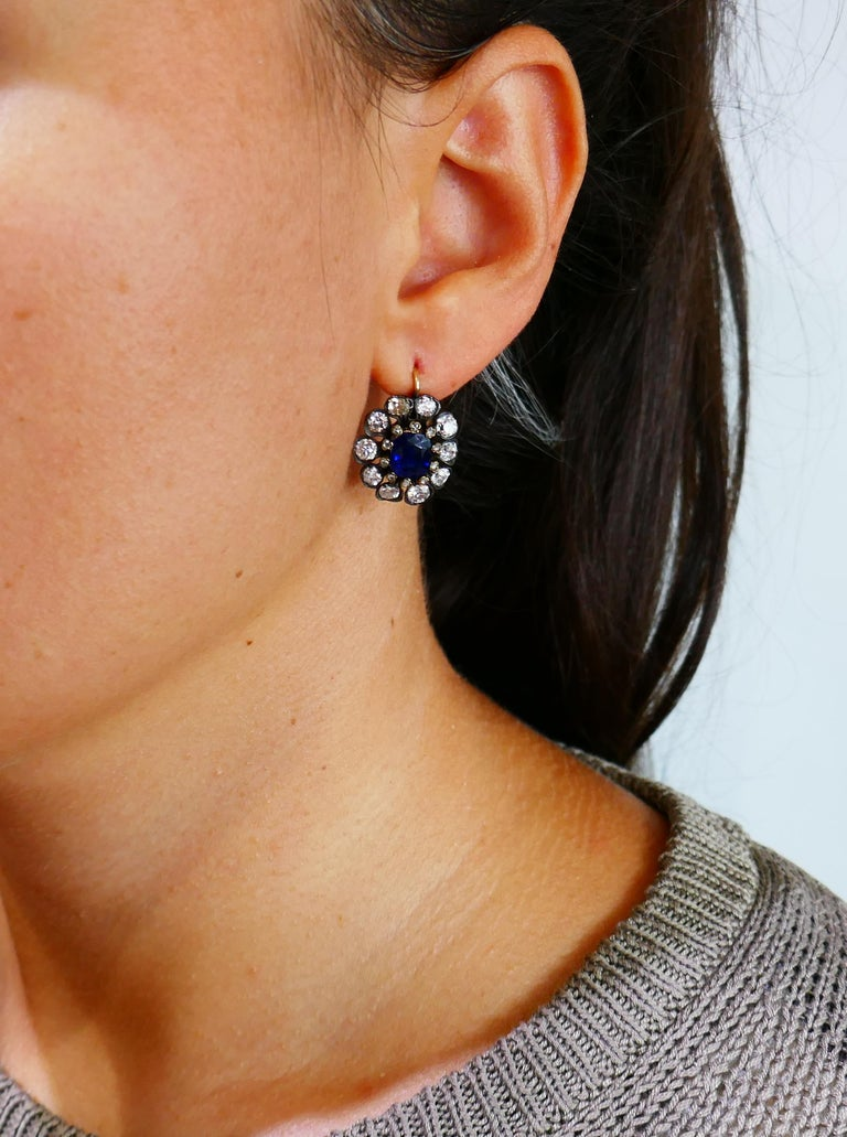 Gorgeous Victorian cluster earrings featuring finest quality sapphires and diamonds. Classic and timeless, the earrings are a great addition to your jewelry collection and will definitely become a family heirloom!  The sapphires are oval faceted and