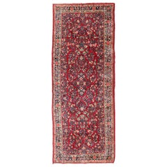 Antique Sarouk Long Gallery Runner with All-Over Flower Design in Red Background