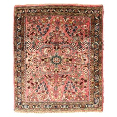 Antique Sarouk Rug in Small Size with Red Field, Colorful Florals, Medallion