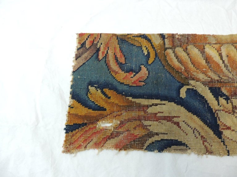 Antique Savonnerie rug fragment Scrolling fragment with and urn and pastel blue coloration. Small hole from aged. Ideal to frame or to make a pillow. Size: 8