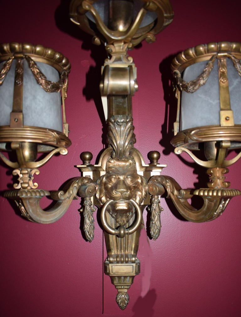 Very fine pair of three-light gilt bronze sconces in the Louis XIV style with alabaster shades.