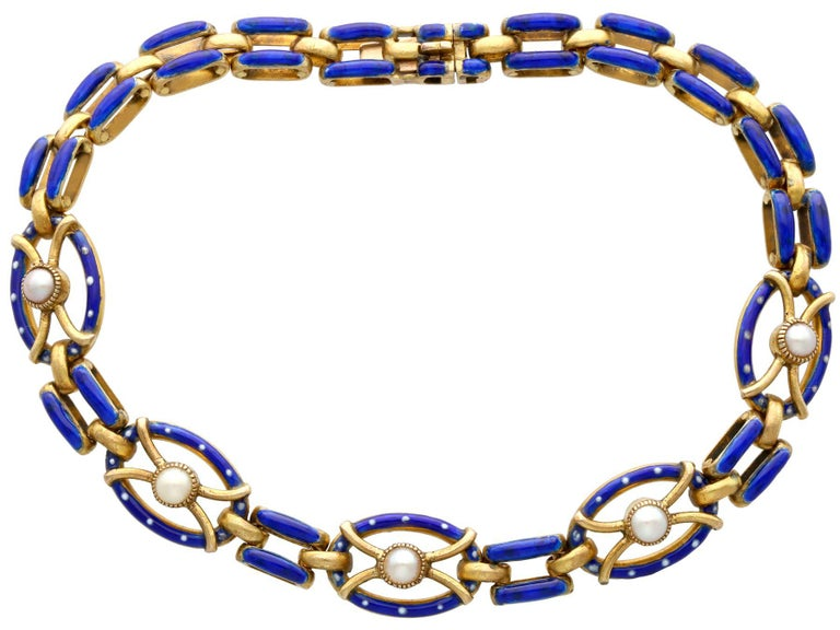 A stunning, fine and impressive antique seed pearl and hot enamel, 21 karat yellow gold gate bracelet; part of our diverse antique jewelry collections  This stunning antique Victorian bracelet has been crafted in 21k yellow gold.  The five oval
