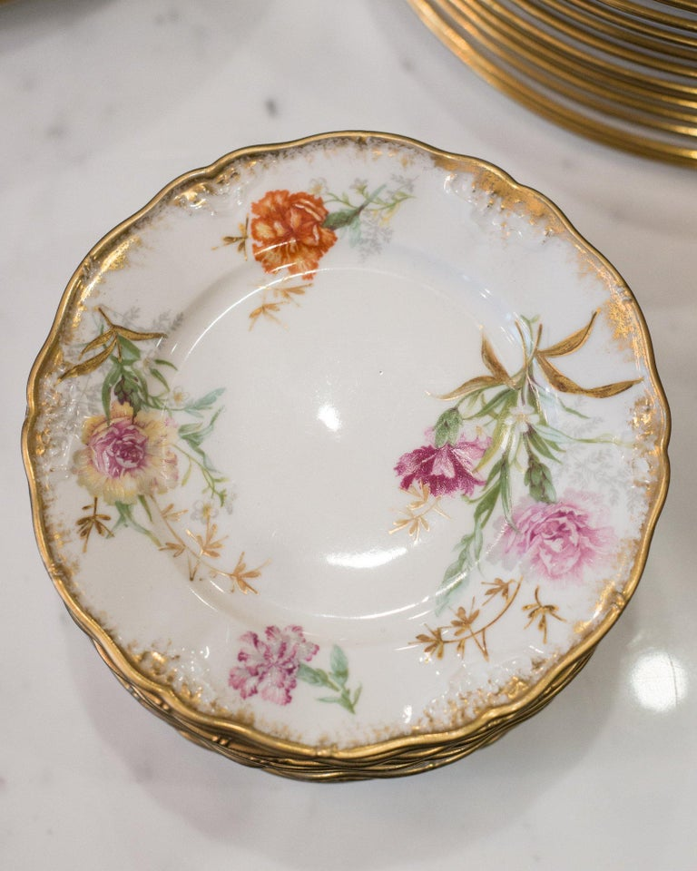 A set of 10 antique France Dépose floral and gold side plates for J.E. Caldwell.
