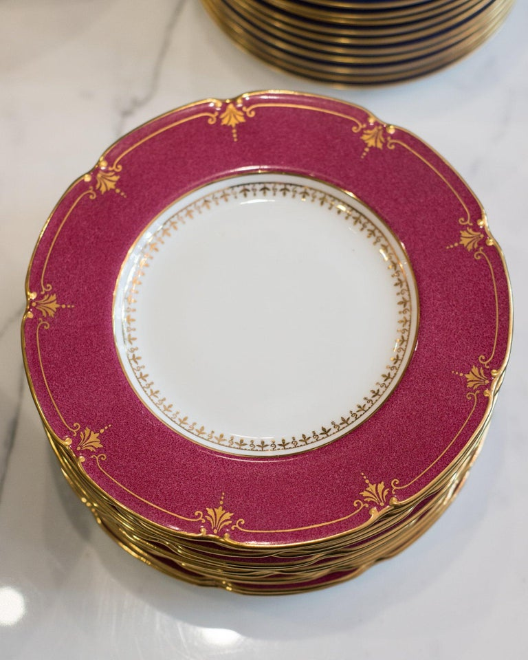 A set of 12 antique Wedgwood cranberry side plates, made in England for Bailey, Banks & Biddle Co Philadelphia, circa early 19th century. Delicately and ornately gilt, the cranberry color is sure to delight.