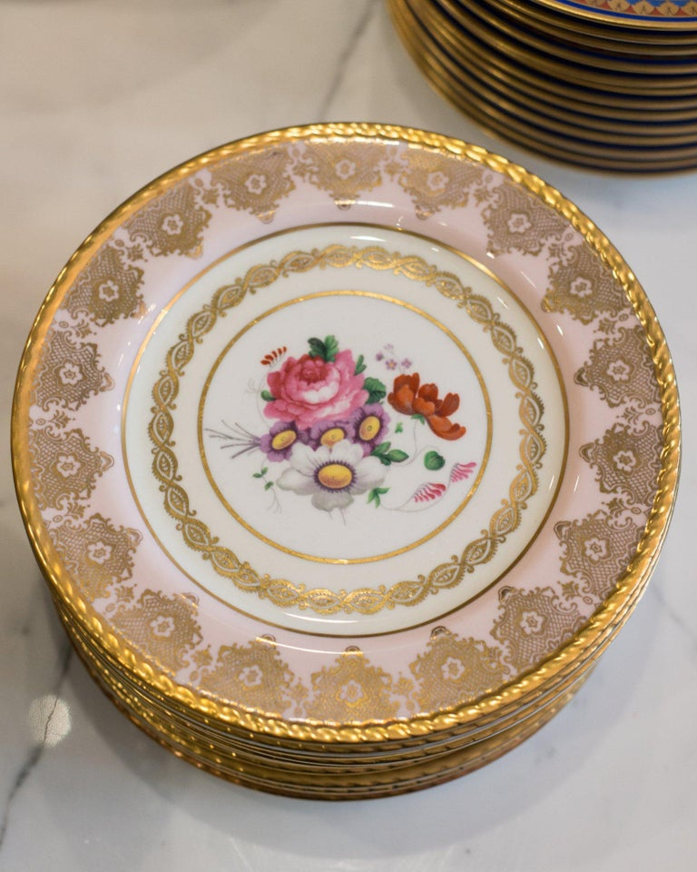 A set of 15 Antique Paragon pink and gold dessert plates, produced in England between 1945-1955. Delicately painted and ornately gilt, the soft pink colour is sure to delight.  The Paragon China Company was a British manufacturer of bone china