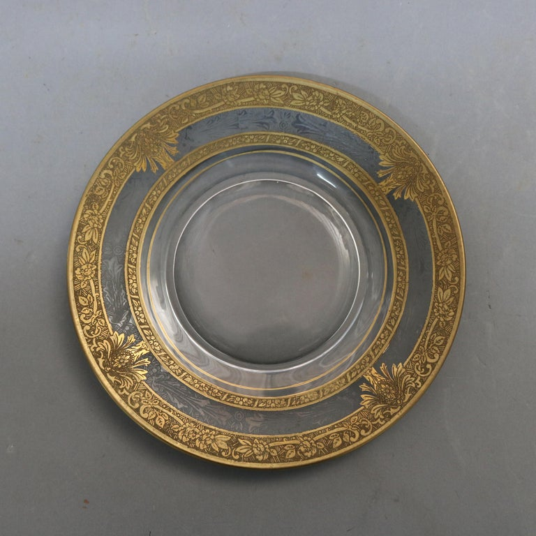 An antique set of 16 dessert plates each offers colorless glass with foliate etched rim with fruit, scroll and foliate gold gilt decoration, 20th century  ***DELIVERY NOTICE – Due to COVID-19 we are employing NO-CONTACT PRACTICES in the transfer of