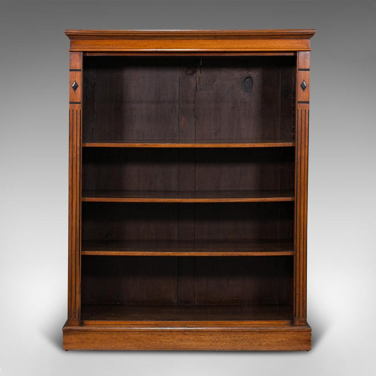 This is an antique set of bookshelves. An English, walnut open bookcase with adjustable shelves, dating to the Victorian period, circa 1880.  Attractive bookshelf with fascinating Doric overtones Displaying a desirable aged patina and in good