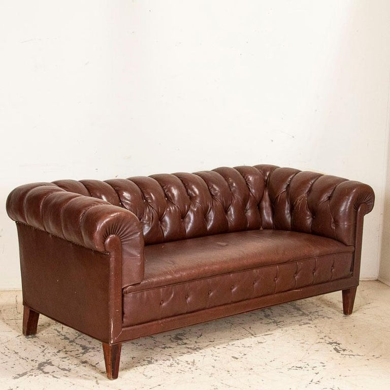 It's not often we find a complete set of vintage Chesterfield sofa and club chairs, so this set is a fun find. Please note this set is all original, so the brown leather does show wear, nicks, some impressions, etc. which is common and expected in