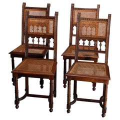 Antique Set of Four Italian Carved Walnut and Caned Dining Chairs, circa 1900