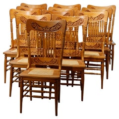 Antique Set of Twelve Oak Spindle & Pressed Back Dining Cane Seat Chairs, c1910