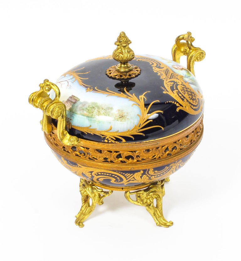 A 19th century Louis Philippe serves porcelain Pot-Pourri decorated with a lady and cherub, having pierced ormolu mounts and feet; fully marked inside the lid 20 cm high, 18 cm high, 17cm diameter.  This is a beautiful French 19th century Louis