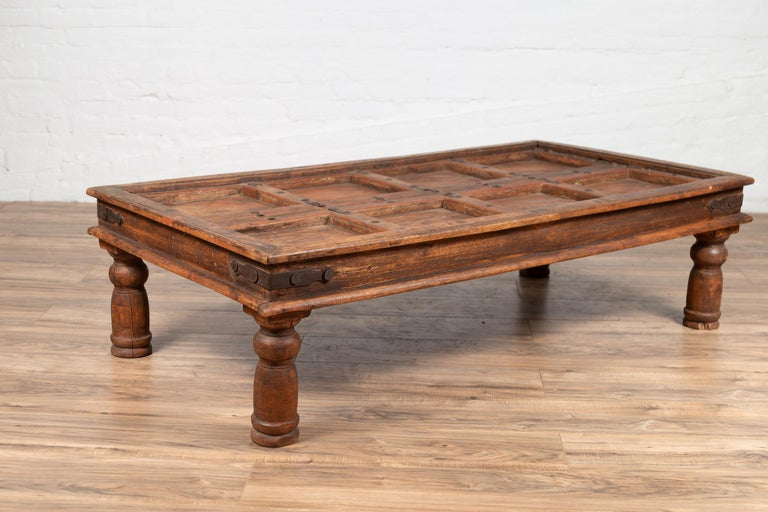 Antique Sheesham Wood Indian Palace Door Made into Coffee Table with Iron Studs For Sale 9
