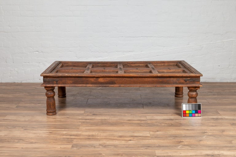 Antique Sheesham Wood Indian Palace Door Made into Coffee Table with Iron Studs For Sale 10