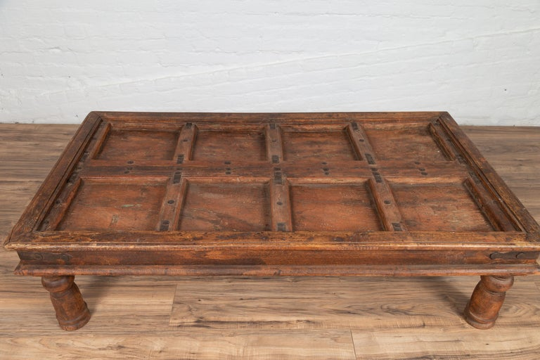 Antique Sheesham Wood Indian Palace Door Made into Coffee Table with Iron Studs In Good Condition For Sale In Yonkers, NY