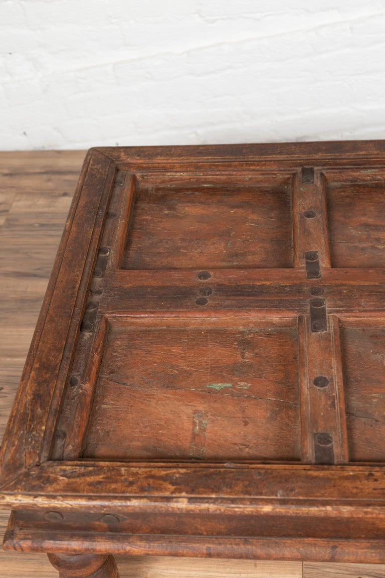 20th Century Antique Sheesham Wood Indian Palace Door Made into Coffee Table with Iron Studs For Sale