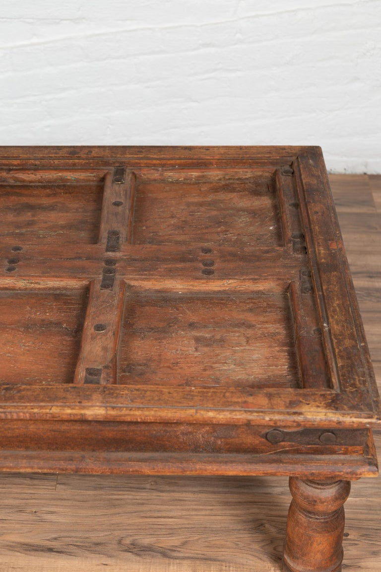 Antique Sheesham Wood Indian Palace Door Made into Coffee Table with Iron Studs For Sale 2