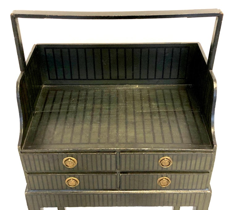 This extremely rare, one of a kind, so called 'Cheveret', is made in England in the Sheraton period, circa 1790, out of beechwood. It still has it's original dark green paint with black stripes. The four small drawers have their original round brass