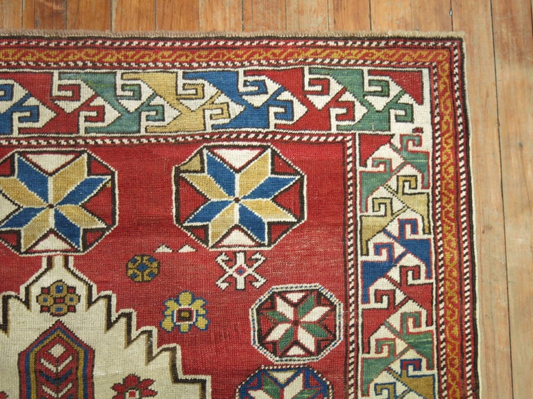 A geometric tribal looking Caucasian shirvan rug from the early part of the 20th century.  Antique Caucasian rugs from the Shirvan district village are still considered one of the best decorative and collector type of rugs from that the Caucasian