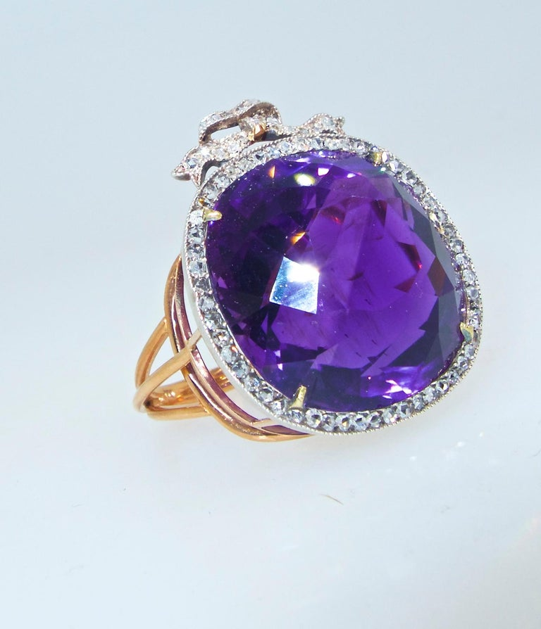 The Siberian amethyst is a pure royal purple color with a hint of red.  It bears the classic Siberian color seen in 19th century jewelry.  This center stone weighs approximately 28.5 cts and is surrounded by 57 small rose cut diamonds with a rose