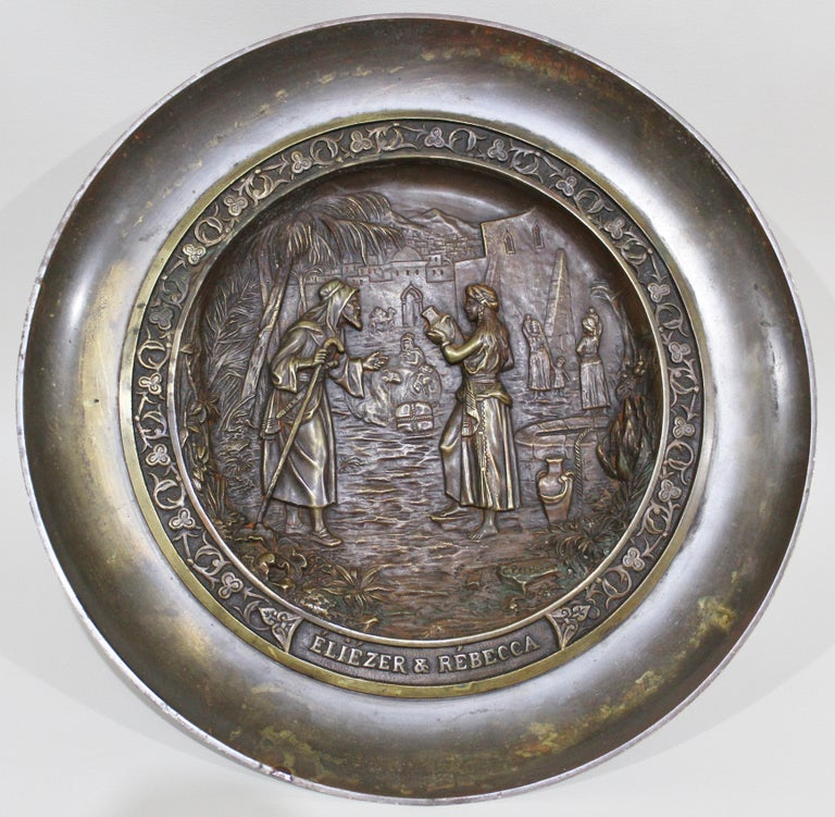 Signed C. Perron cast bronze tazza depicting the Judaic allegorical story of Eliezer finding a wife for Abraham's son Isaac and with the assistance of Rebecca, determines she is the best choice for him. The tazza is clearly signed