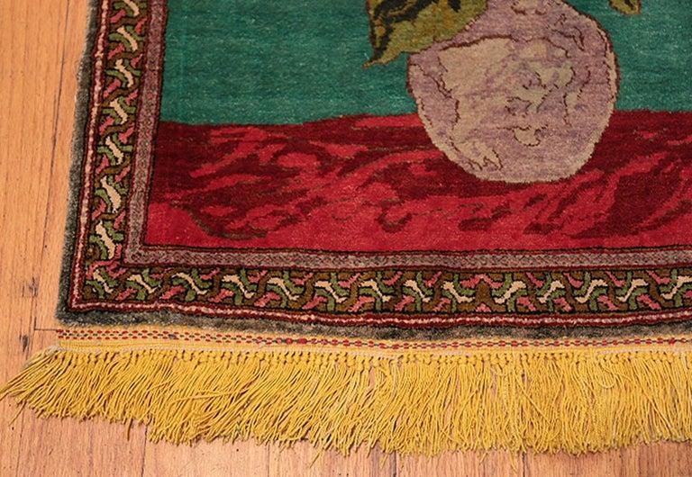 Antique silk Tabriz Persian rug, origin: Persia, circa first quarter of the 20th century. Size: 1 ft 10 in X 2 ft 8 in (0.56 m x 0.81 m).