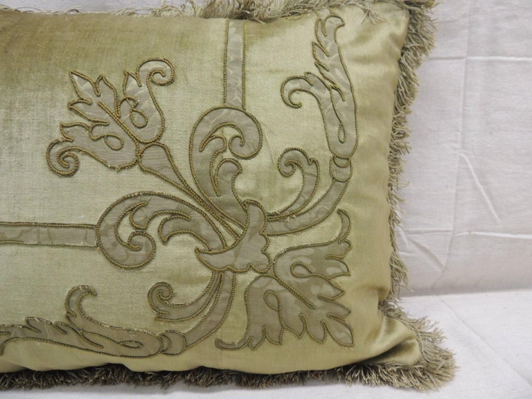 Antique silk velvet olive green applique decorative Bolster pillow. Silk brocade embroidered green silk threads and applied onto silk velvet. Original silk brush trim from panel was used on pillows all around as trim. (New) small check green and