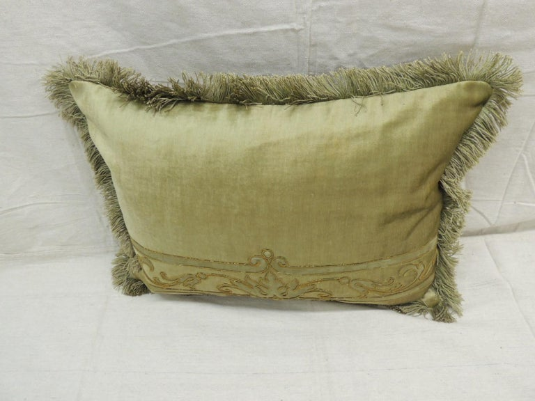 Antique silk velvet olive green applique decorative Bolster pillow. Silk brocade embroidered green silk threads and applied onto silk velvet. Original silk Brush trim from panel was used on pillows all around as trim. (New) small check geen and