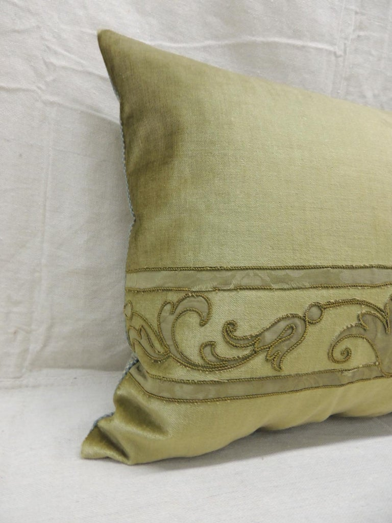 Antique silk velvet olive green applique decorative bolster pillow. Silk brocade embroidered green silk threads and applied onto silk velvet. (New) small check green and gold pattern was used on backings. This textile was originally a table