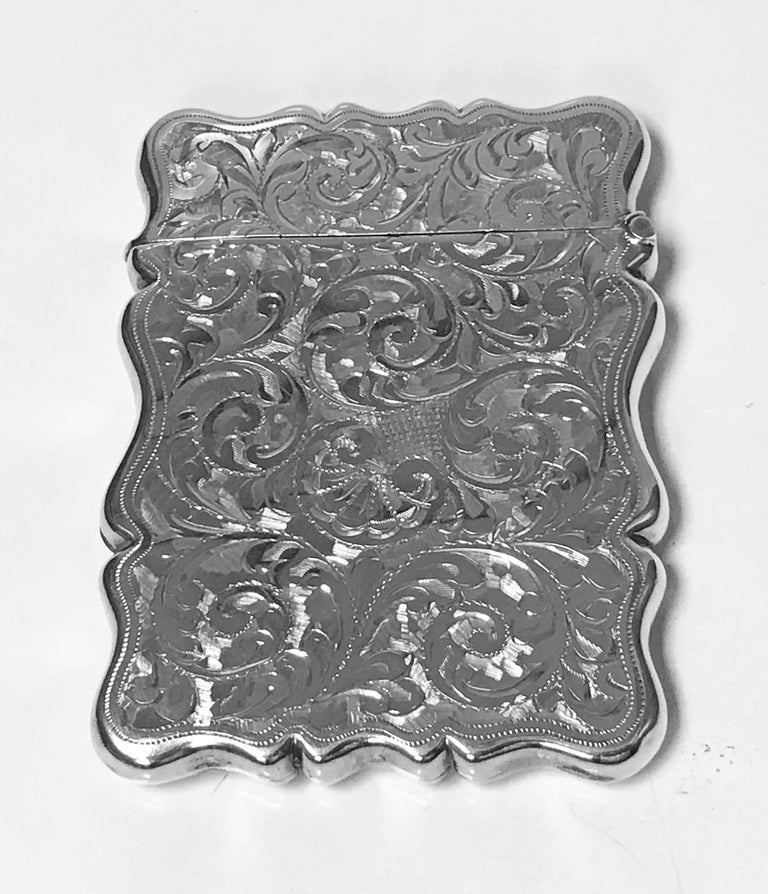 Antique Silver Card Case, Birmingham 1906, Joseph Gloster. Very finely engraved foliage. Vacant cartouche to front. Measures: 3.6 x 2.6 inches. Item Weight: 60.70 grams. Fully hallmarked.