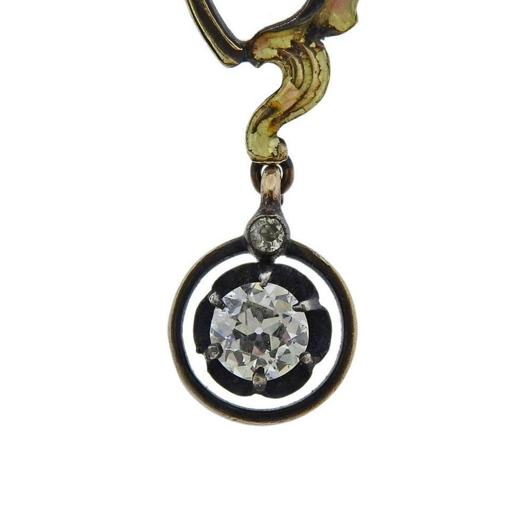 14k gold and silver antique brooch pendant, set with plique-a-jour enamel and a combination of rose cut and old mine and Euro cut diamonds (approx. 2.10ctw). Measures 80mm x 50mm, minor chip on enamel on the right edge of the brooch. weighs 23.3