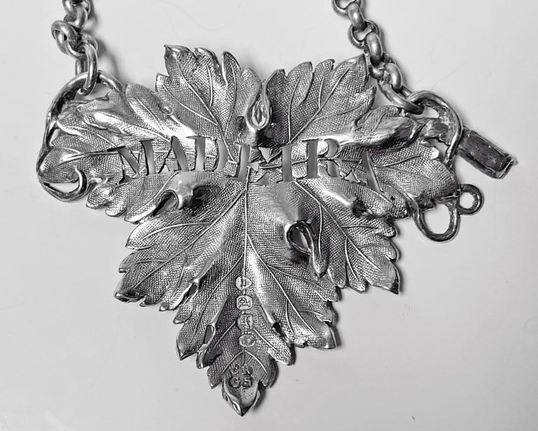 Antique silver Madeira Wine label, London 1830, Reily & Storer. The label of vine leaf form, realistic textured decoration, original chain link attached. Fully hallmarked. Measures: 2.5 x 2 inches (5x2 including chain). Weight: 18.4 gm.