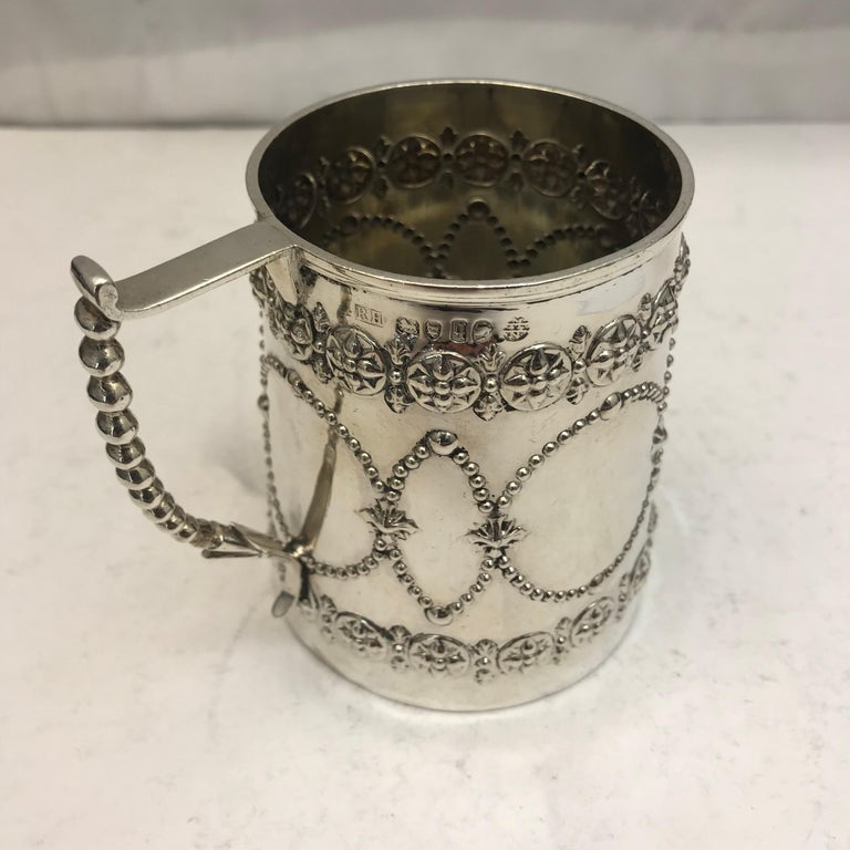 Small 19th century silver mug, decorated beautifully with a delicate handle.